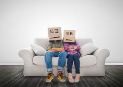 Couple wearing humorous boxes on their head - stock photo