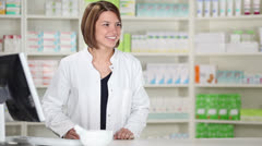 Female pharmacist with customer Stock Footage
