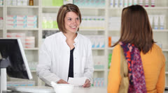Friendly talk in the pharmacy - stock footage