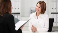 Young female candidate in job interview Stock Footage
