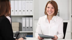 Businesswoman smiling at camera during an job interview Stock Footage
