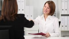Businesswoman shaking hands with candidate - stock footage