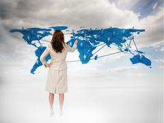 Businesswoman touching at a world map - stock photo