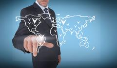 Businessman selecting a white world map - stock photo