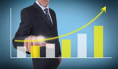 Stock Photo of Businessman touching a growing chart