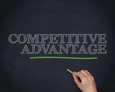 Hand underlining the word competitive advantage in green Stock Photos
