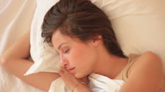 Beautiful girl sleeps in the bedroom - stock footage