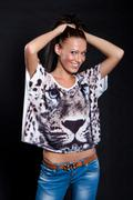 long-haired woman in shirt with tiger - stock photo