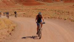 Desert Mountain Biking Up Hill Accent - stock footage