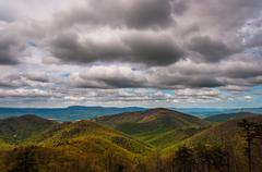 spring colors in the appalachians on a cloudy day, seen from skyline drive in - stock photo