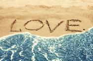 Lettering LOVE on the beach Stock Illustration