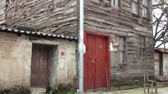 Old wrecking wooden house tilt Stock Footage