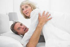 Shocked couple caught in the act Stock Photos