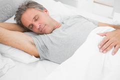 Man sleeping peacefully Stock Photos