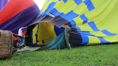 Pilots of balloon are heating the air before takeoff Stock Footage