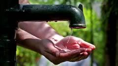 Washing hands under the water pump. Stock Footage
