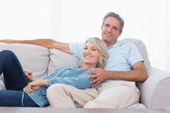 Stock Photo of Happy couple relaxing at home