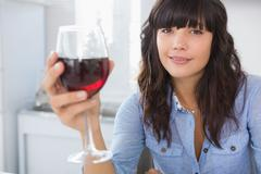 Stock Photo of Pretty brunette having glass of red wine