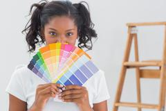 Happy woman showing colour charts Stock Photos