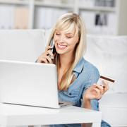 calling woman with credit card - stock photo