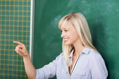 Teacher pointing on someone in the classroom Stock Photos