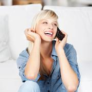Laughing woman on phone Stock Photos