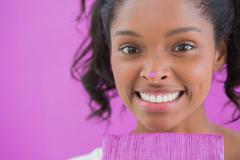 Happy woman holding paintbrush with paint on her nose Stock Photos