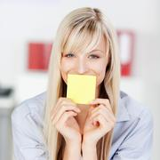 Woman with sticky note Stock Photos