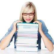 young lady with stack of books - stock photo
