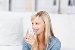 woman drinking mineral water - stock photo