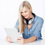 Woman with headphone and tablet Stock Photos