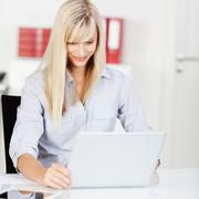 modern young woman working on her laptop - stock photo