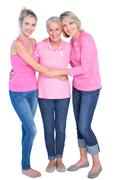 Cheerful women wearing pink tops and ribbons for breast cancer Stock Photos