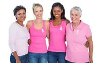 Stock Photo of Smiling women wearing pink tops and breast cancer ribbons