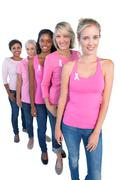 Happy women wearing pink and ribbons for breast cancer Stock Photos