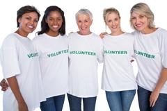 Group of female volunteers smiling at camera - stock photo