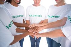 Group of female volunteers with hands together Stock Photos