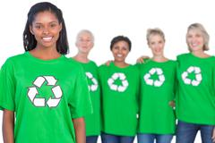 Team of female environmental activists smiling at camera Stock Photos