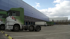 Lorry loading bays at distribution warehouse in England Stock Footage