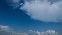 Classic time-lapse of clouds passing by. Blue sunny sky - stock footage