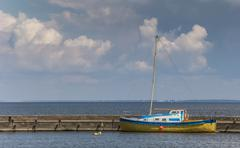 Blue and yellow boat on the curonian spit Stock Photos
