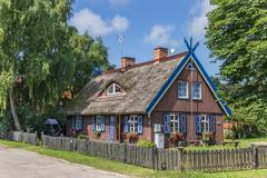 Traditional wooden house on curonian spit Stock Photos