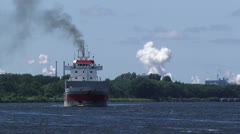 NORTH SEA CANAL Dry cargo carrier eastbound to Amsterdam - on camera Stock Footage