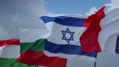 Israeli, French, Bulgarian, Hungarian flags. Peaceful meeting, European states Stock Footage