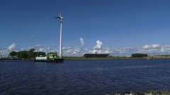 Public transport Ferry + pan North Sea Canal, cruise ship approaching Stock Footage