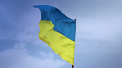 Ukrainian national flag waving on flagpole in blue sky. Ukraine Stock Footage