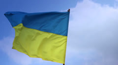 Flag of Ukraine on flagstaff. Ukrainian national flag. Stock Footage