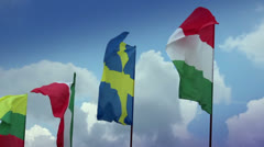 Various flags on flagpoles: Sweden, Hungarian, Italian, Romanian. Sweden, Italy Stock Footage