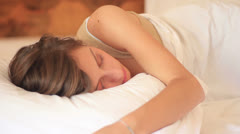 Beautiful girl sleeps in the bedroom Stock Footage