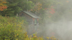 Lake boathouse on foggy autumn morning Stock Footage